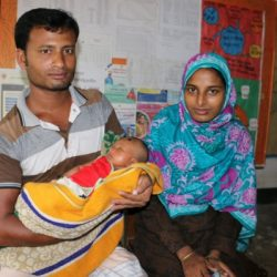 Golapy, her husband Manik and their baby attend a check up at the Union Health & Family Welfare Centre in Bangladesh