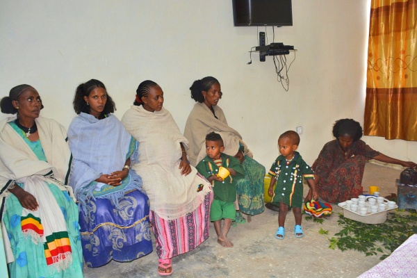 Group of pregnant women and two children sitting in a row